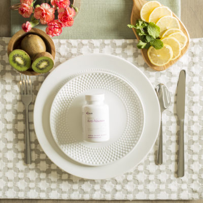 anti-nausea and morning sickness supplements on a dinner plate surrounded by fruit